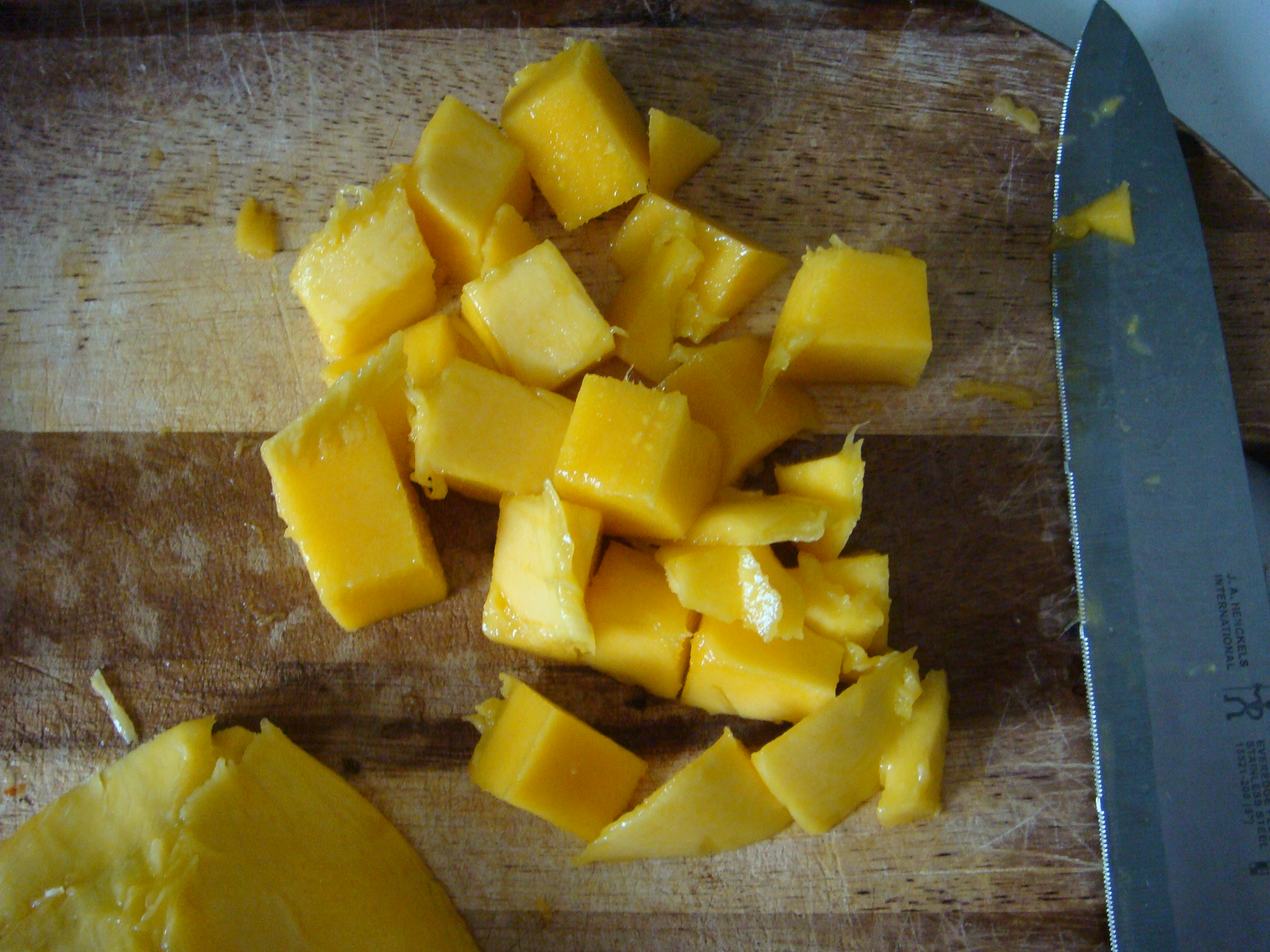 First, Cut The Mangoes Into Cubes Watch My Video To See How Don't Dump  All The Mango Chunks Into A Freezer Bag Before Storing In The Freezer,