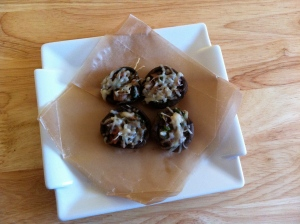 Stuffed mushrooms on waxed paper